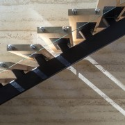 This glass, steel and wood staircase runs up stairs, structure, gray