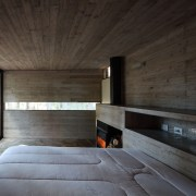 The bedroom features a narrow window running along architecture, daylighting, house, interior design, wood, black, gray