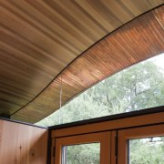 Windows seem to hold the vaulted ceiling in architecture, beam, ceiling, daylighting, home, house, real estate, roof, siding, window, wood, wood stain, brown