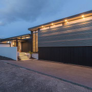 The view from the driveway architecture, building, estate, facade, garage, garage door, home, house, property, real estate, residential area, siding, teal, black