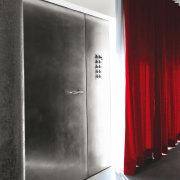 Architect: Tisselli Studio door, floor, interior design, wall, black, red