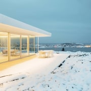 The home lights up at night home, real estate, sea, sky, snow, vacation, winter, white, teal