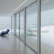 A recessed light strip in the ceiling helps daylighting, door, glass, interior design, window, gray