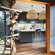 The kitchen opens up to the deck floor, flooring, furniture, home, interior design, table, window, wood, black