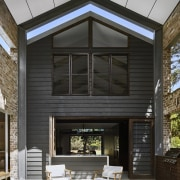 A view of the outdoor room - A facade, home, house, interior design, residential area, siding, window, black, gray