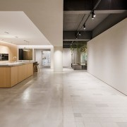 The spaces blend together seamlessly - The spaces ceiling, floor, flooring, hardwood, interior design, laminate flooring, lobby, real estate, tile, wood flooring, gray