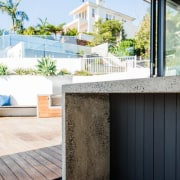 A concrete bench means a strong, sturdy workspace architecture, balcony, home, house, interior design, property, real estate, wall, window, white