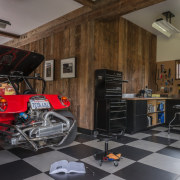 There's plenty of room for projects in the automobile repair shop, automotive exterior, car, floor, flooring, motor vehicle, vehicle, brown, black, gray