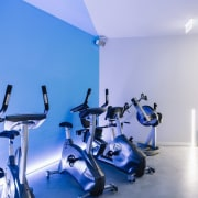 Blue and white feature throughout the centre - gym, room, sport venue, structure, blue, teal