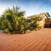 If you are looking for a stylish, hardy, arecales, backyard, deck, estate, home, house, landscape, landscaping, outdoor structure, palm tree, plant, property, real estate, roof, sky, tree, wood, brown, orange