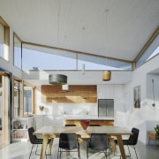 A white ceiling helps to create a large, architecture, ceiling, daylighting, house, interior design, real estate, gray
