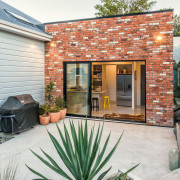 New Zealand Architecture Awards backyard, cottage, courtyard, door, home, house, property, real estate, siding, window, yard, white, gray