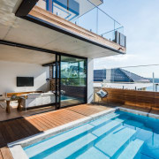 The sitting area opens right out to the deck, estate, house, penthouse apartment, property, real estate, swimming pool, white