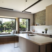 The kitchen is spacious and filled with natural architecture, countertop, house, interior design, kitchen, real estate, window, white