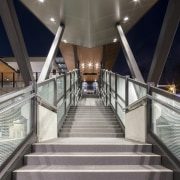 Cheltenham Station – Cox Architecture architecture, daylighting, escalator, handrail, metropolitan area, stairs, structure, symmetry, gray, black