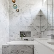 A unique tile pattern, coupled with a clerestory architecture, bathroom, ceiling, daylighting, floor, flooring, home, interior design, product design, room, tap, tile, wall, gray, white