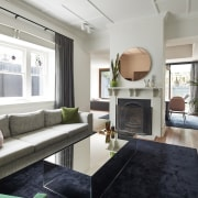 The renovation respects the original home, with ceiling ceiling, floor, interior design, living room, room, table, gray, black