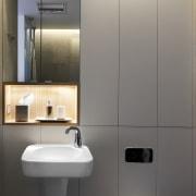 These grey panels hide storage cupboards - These bathroom, bathroom accessory, bathroom cabinet, bathroom sink, interior design, plumbing fixture, product design, room, sink, tap, toilet, gray