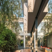 It's certainly a small lot, but the home architecture, courtyard, daylighting, home, house, mixed use, outdoor structure, real estate, black, brown