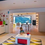 This living area is perfect for young children. exhibition, interior design, gray