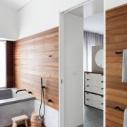 The entry from the master bedroom is simple, architecture, door, floor, interior design, wood, white, gray