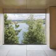 Nothing interrupts the views – aside from the architecture, daylighting, home, house, interior design, property, real estate, wall, window, brown