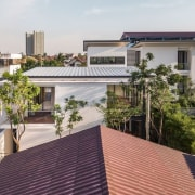 The home nestles into the surrounding urban environment apartment, architecture, balcony, building, condominium, daylighting, facade, home, house, mixed use, outdoor structure, property, real estate, residential area, roof, gray