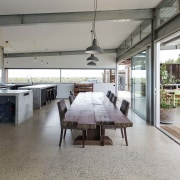 The kitchen is certainly an entertainer's dream - floor, flooring, interior design, real estate, gray