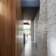 Brick, concrete and timber meet in this hallway architecture, daylighting, house, wall, wood, gray, brown