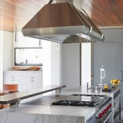 A mitred granite benchtop with waterfall ends is ceiling, countertop, interior design, kitchen, gray