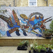 An interesting painting in the back garden draws art, graffiti, mural, street art, wall, gray