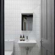 White tiles keep the bathroom feeling open - bathroom, bathroom accessory, bathroom cabinet, floor, interior design, plumbing fixture, product design, room, sink, tile, gray