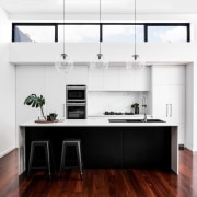 Clerestory windows light up the kitchen during the countertop, house, interior design, kitchen, real estate, white