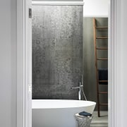 While the freestanding tub and walnut towel-rail ladder bathroom, bathroom accessory, bathroom cabinet, door, floor, interior design, room, tap, wall, window, gray