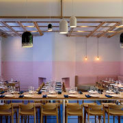 Pastel pinks compliment the blue floors. Architect: