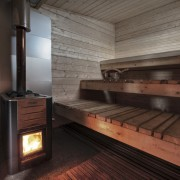Architect: TYIN tegnestue ArchitectsPhotographer: Pasi Aalto / hearth, wood, black, gray