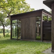 Dark stained timber lines these walls architecture, facade, home, house, outdoor structure, real estate, shed, black, green