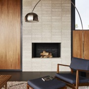 The fireplace sits tucked into the wall architecture, ceiling, chair, fireplace, floor, flooring, furniture, hearth, interior design, living room, table, wall, gray