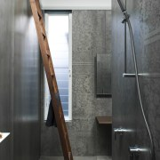 An almost room-height ladder in walnut – matching architecture, floor, flooring, handrail, interior design, tap, gray, black