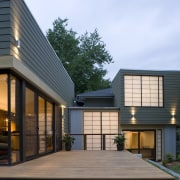 The yard at dusk - The yard at architecture, building, daylighting, elevation, estate, facade, home, house, real estate, residential area, roof, siding, window, teal