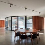 Looking past the dining room into the pool architecture, ceiling, daylighting, floor, flooring, house, interior design, living room, loft, property, real estate, table, gray
