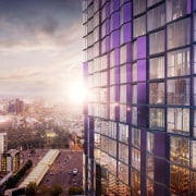 The purple certainly stands out - The purple apartment, architecture, building, city, cityscape, commercial building, condominium, daytime, downtown, evening, facade, metropolis, metropolitan area, mixed use, reflection, residential area, sky, skyline, skyscraper, sunlight, tower block, urban area, window, gray