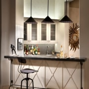 Three pendant lights hang above this bar area cabinetry, countertop, cuisine classique, furniture, interior design, kitchen, table, gray, brown