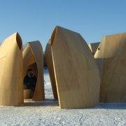 Architect: Patkau ArchitectsPhotography by James Dow architecture, memorial, monument, sculpture, snow, winter, wood, teal
