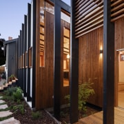 A view from the garden into the kitchen architecture, facade, home, house, property, real estate, siding, wood, black