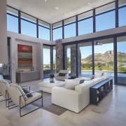 Substantial clerestory windows light up this living area ceiling, daylighting, estate, floor, house, interior design, living room, penthouse apartment, property, real estate, window, gray