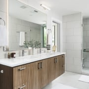 This master ensuite features a floating vanity and bathroom, bathroom accessory, bathroom cabinet, cabinetry, countertop, cuisine classique, floor, interior design, kitchen, product design, room, sink, tap, white, gray