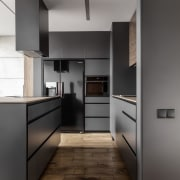 Architect: MetaformaPhotography by Krzysztof Strażyński cabinetry, countertop, floor, home appliance, interior design, kitchen, product design, gray, black
