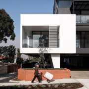 This white 'block' draws the eye architecture, building, condominium, facade, house, residential area, black