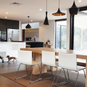 The kitchen flows into the dining room – countertop, dining room, furniture, interior design, kitchen, room, table, gray